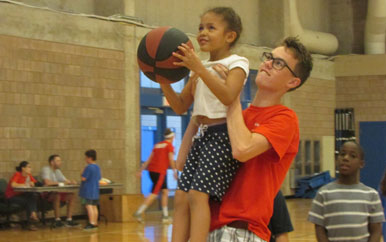 Camp Shriver kids playing basketball