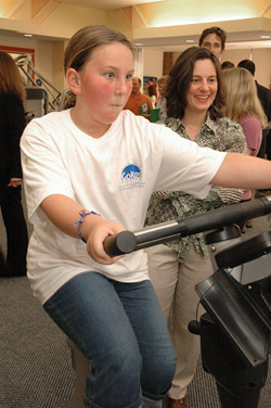 girl on exercise bike with adult