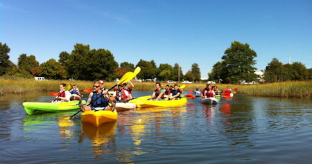 Students kayaking in the Biomimicry LivingLabs  Savin Hill Cove