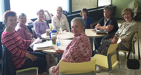 A photo of the book group members having their monthly meeting in the OLLI Lounge