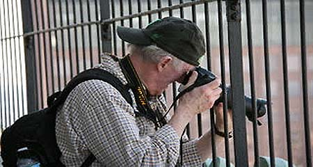 Photo of OLLI members Jim McEneaney taking a photo at the Custom House Observation Platf