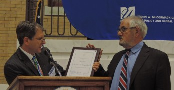 Dean David W. Cash presents certificate to Congressman Barney Frank for his dedicated public service.