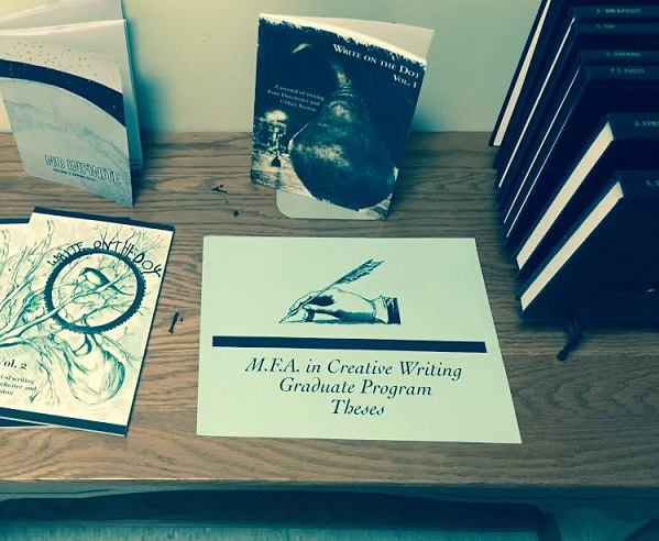 Display of publications, one which says MFA in Creative Writing Program Thesis