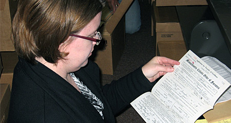 Woman going through archived documents