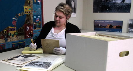 Picture of student sorting through archived documents