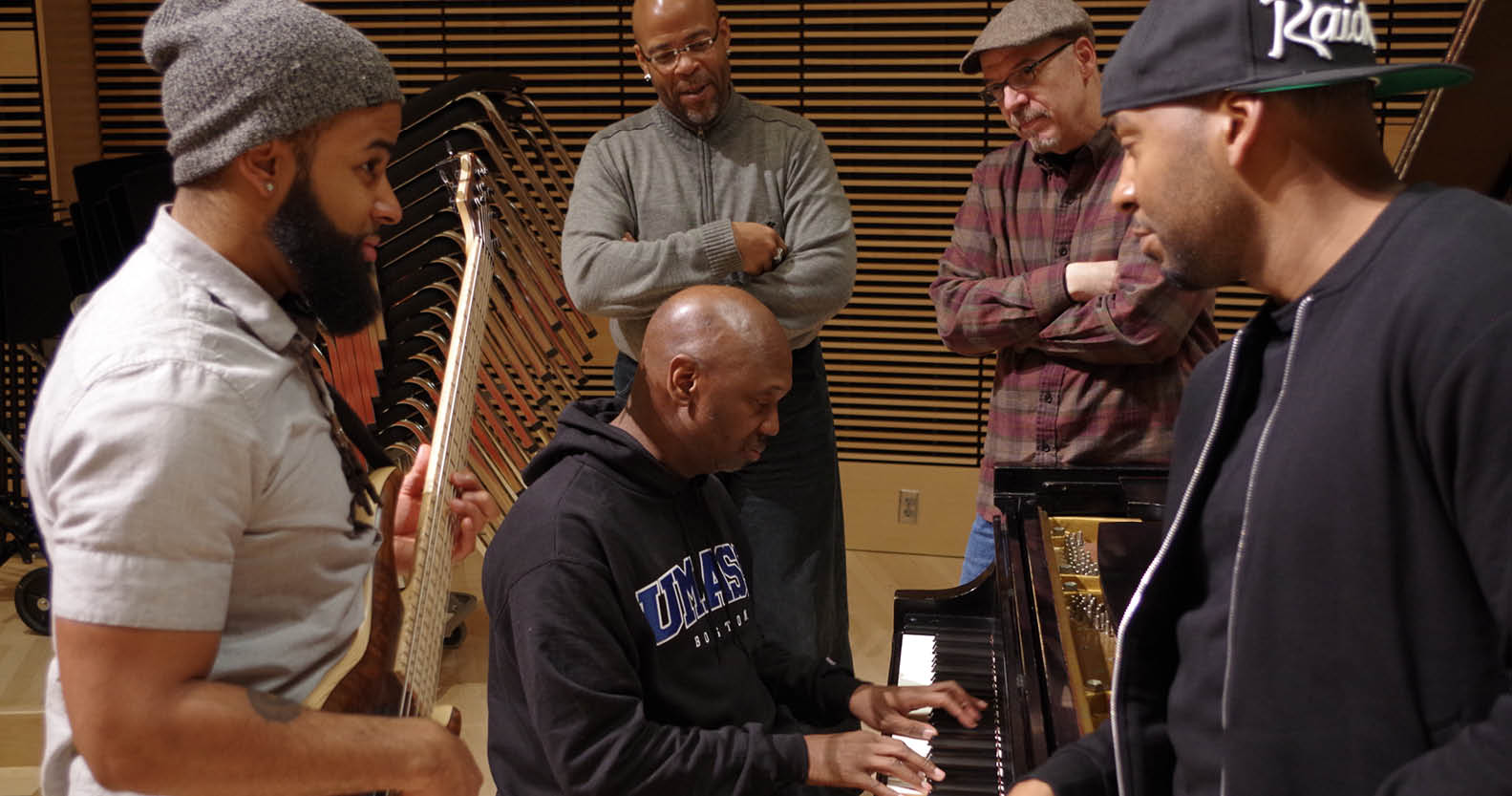 The UMass Boston Trio (from left, Domenic Davis, Anthony Martin, and Brian Hull) with Dennis Montgomery III and Peter Janson