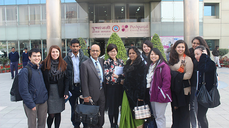 Group of UMass Boston students in front of a building in India