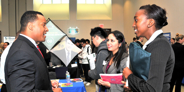 UMass Boston students meet with a prospective employer at the annual Career Expo