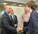 Governor Deval Patrick greeting a student