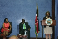 Dr. Stuart-Shor presents the Heart and Sole agenda and achievements to the Prime Minister (center) during a private meeting at his office