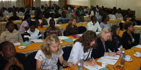 A section of US and Kenyan students, clinicians and faculty who attended the 2012 Kenya Heart and Sole Project debriefing conference in Nairobi.