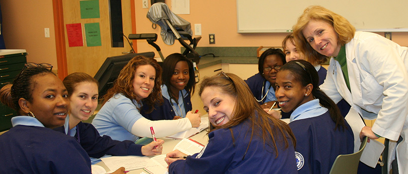 Dr. Kathleen Kafel smiles with her nursing students.