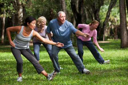 People exercising in a quiet park