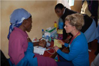Alia MacPherson taking patient medical history and conducting a health screening at Kaiyaba Health Center.