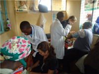 Meagan Suyematsu and Kaitlin Allen conducting a health screening at Kaiyaba Health Center.