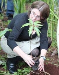 Dr. Stuart-Shor planting a mango tree at Mama Mercy's home.