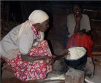 Mercy Kamau's auntie preparing ugali (corn/maize meal) for her family.