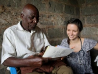 Annya provides education to a gentleman at the Kambui clinic.
