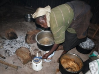 This is a typical kitchen in Kigumo community. The stove is made from three stones on the ground, causing the women to bend over to cook.