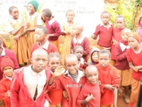 Children from the Kigumo primary school surrounding the bus in excitement to see the Mzungus.