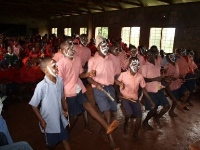 Children from Thageini primary school performing traditional African dances for the US team.