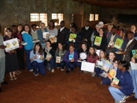 The KHAS 2012 US team presenting children's books to the primary school.