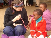 Elyse letting a young Kenyan girl sharing a touching moment on the steps of the community screening.