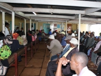 Community members waiting to be seen at the Kigumo community health center.