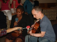 US and Kenyan team members collaborate to perform a duet.