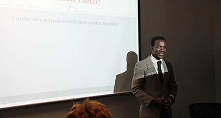 Student Winston Pierre presents to the CDFP 2015 group on his fellowship at the Executive Office of Labor & Workforce Development