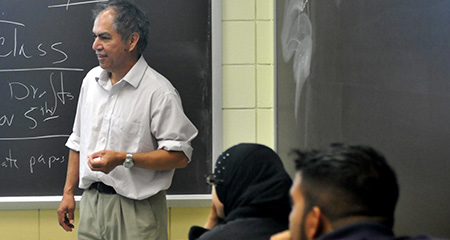 Professor Raul Ybarra, Professional Writing Seminar classroom picture with students