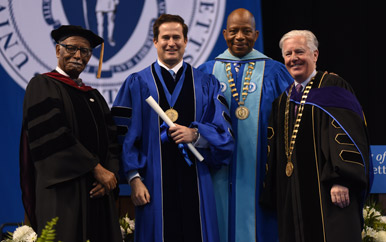 Provost Winston Langley, Rep. Seth Moulton, Chancellor J. Keith Motley, and President Marty Meehan