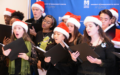 The UMass Boston Chamber Singers wore Santa hats to sing carols in the Campus Center
