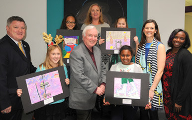 Community Relations staff join student artists Alexis Schrebler and Kathleen Whisler (back), Zoe Sipcic and Natamil Moya (front), Medford Mayor Michael McGlynn '76, and art teacher Jennifer Belanger