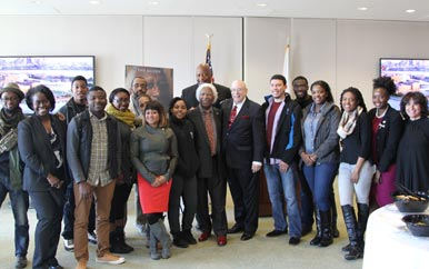 UMass Boston students and staff with musician-turned-businessman Marvin Gilmore.