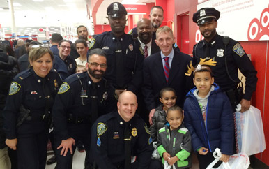 Members of UMass Boston's Department of Public Safety joined the Boston Police Department for Pal Shop with a Cop, Heroes and Helpers 2015