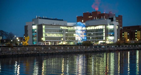 Integrated Sciences Complex at night.