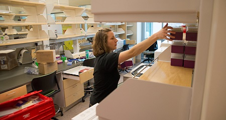Jamie Dombach, a graduate student, getting set up in the Integrated Sciences Complex.