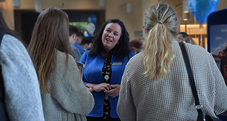 Dean Robyn Hannigan of School for the Environment greets prospective students at Welcome Day.