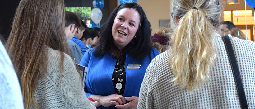 Founding Dean Robyn Hannigan of School for the Environment greets prospective students at Welcome Day.