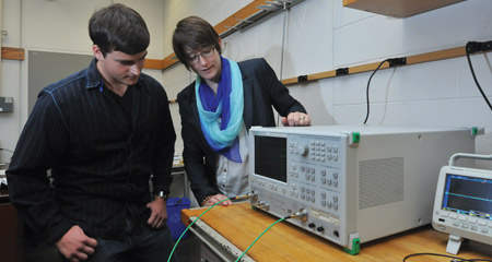K.C. Kerby-Patel and a UMass Boston engineering student work with antennas for wireless devices