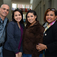 Two parents and two girls in the Campus Center
