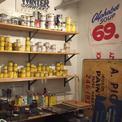 Kenji Nakayama and Pat Falco's studio space includes paint cans and finished and in-progress work.