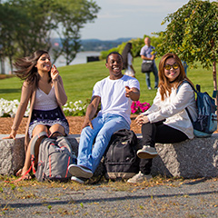 Students sitting and talking on the UMass Boston campus