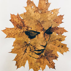 Art of a face in a series of leaves