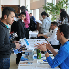 Students at the 2013 STEM Expo meet with prospective employers
