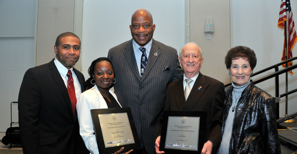 UMass Boston Chancellor J. Keith Motley and Thursday's award recipients, Sophia Haynes-Cardwell and Lou Pasquale.