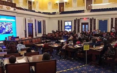 Replica Senate Chamber at the EMK Institute packed of students.