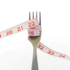 Fork wrapped in measuring tape