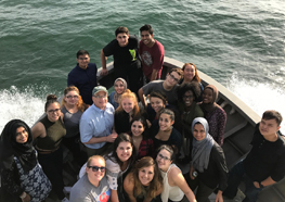 UMass Boston students on a boat